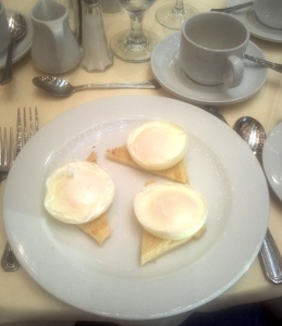 Three poached eggs for breakfast